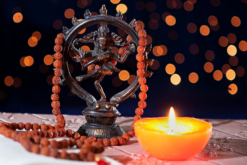 Nataraja figure and candle in mystic light